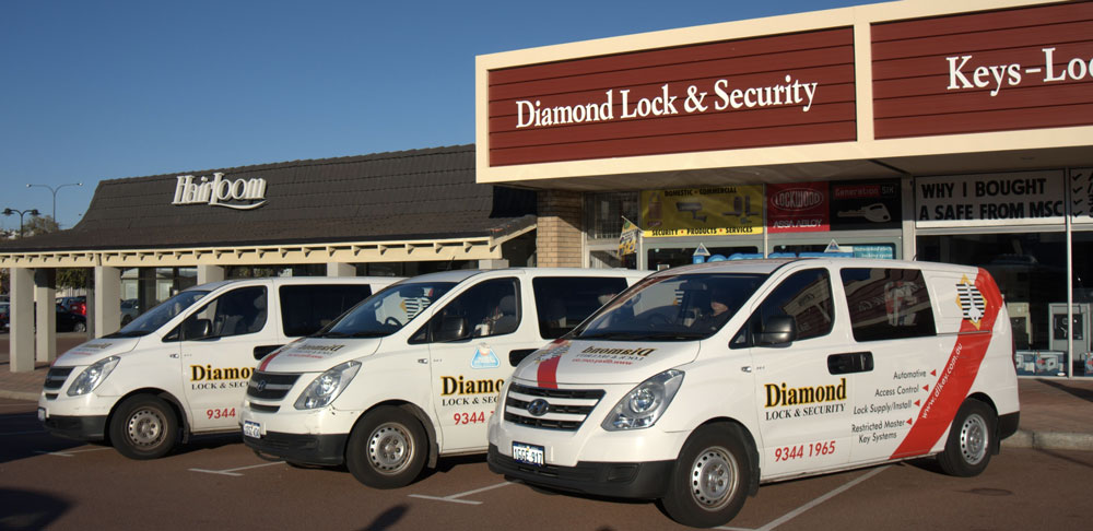 The Diamond Lock and Security car fleet out the front of the building