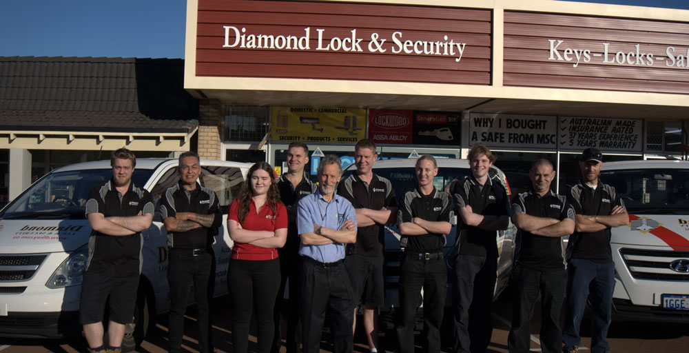The team and Diamond Lock and Security standing out the front of their venue