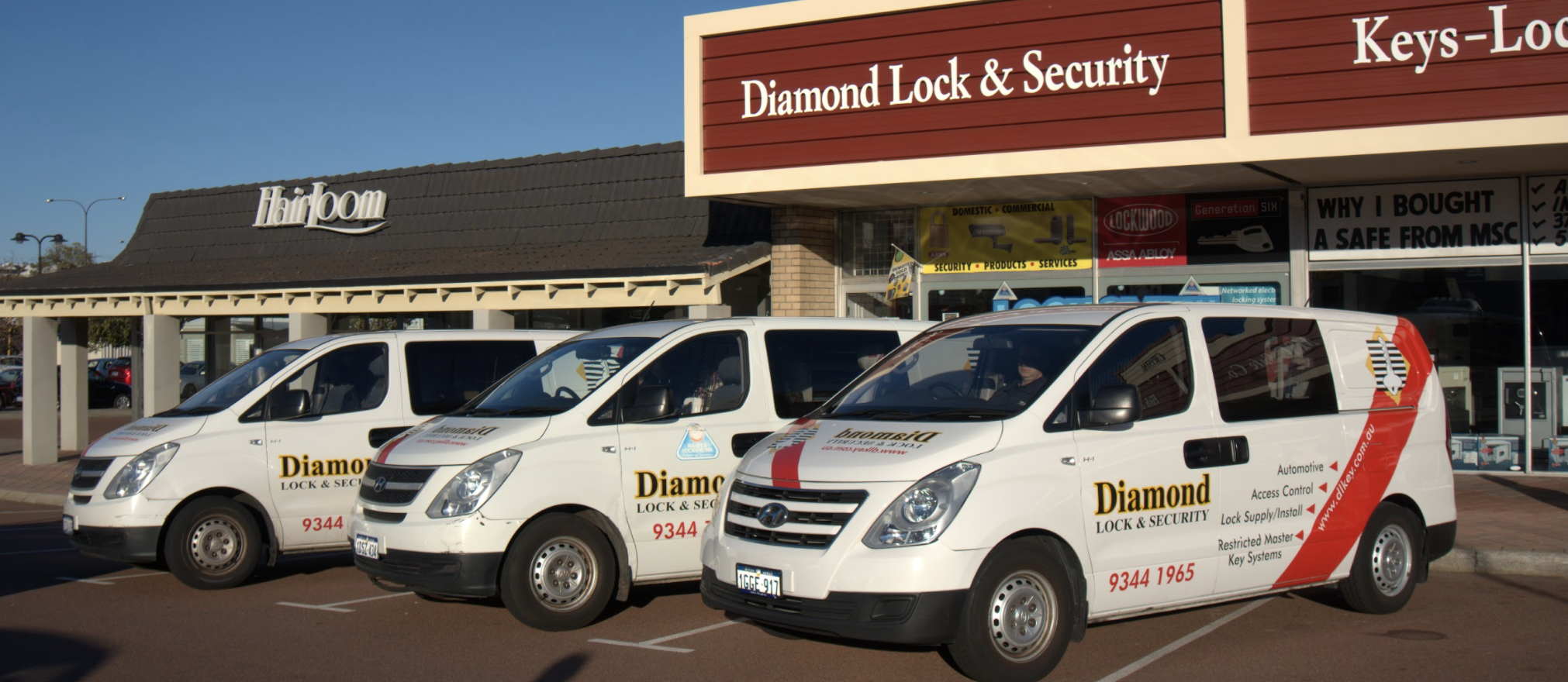 The Diamond lock and security shop front with cars.