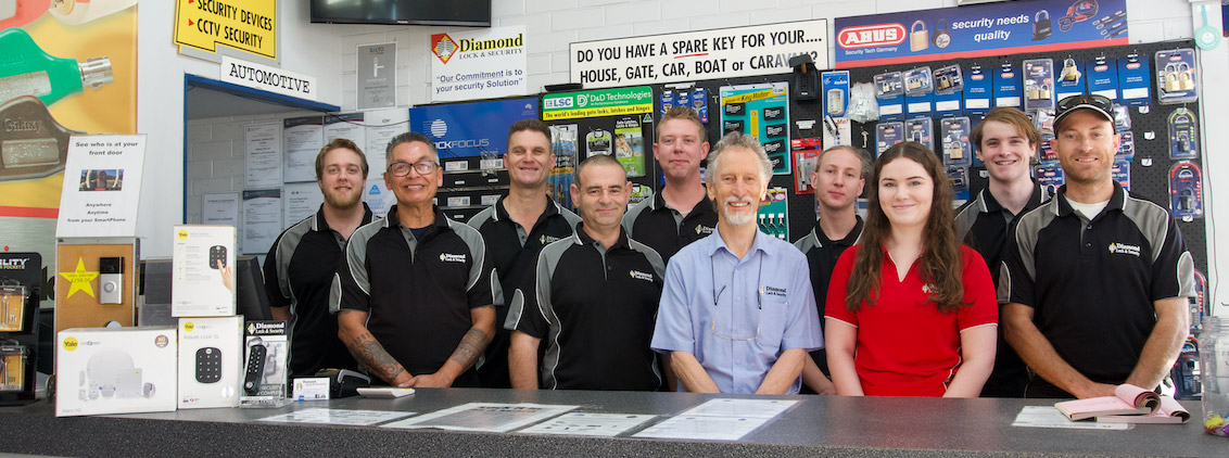 The team at Diamond Lock and Security proudly standing behind the counter.