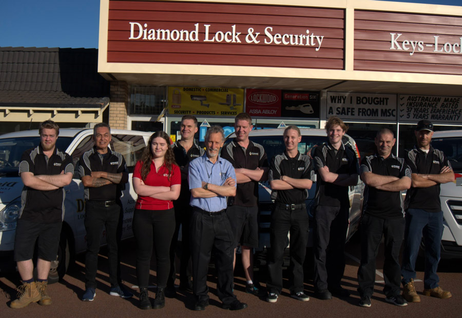 A team of locksmiths standing out the front of Diamond Lock and Security office and workshop.