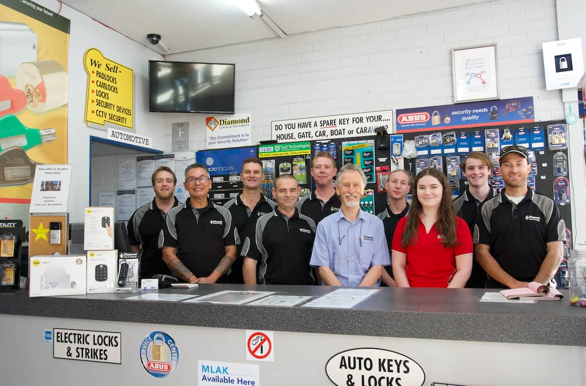 The team of licenced professionals at diamond security standing behind the counter.