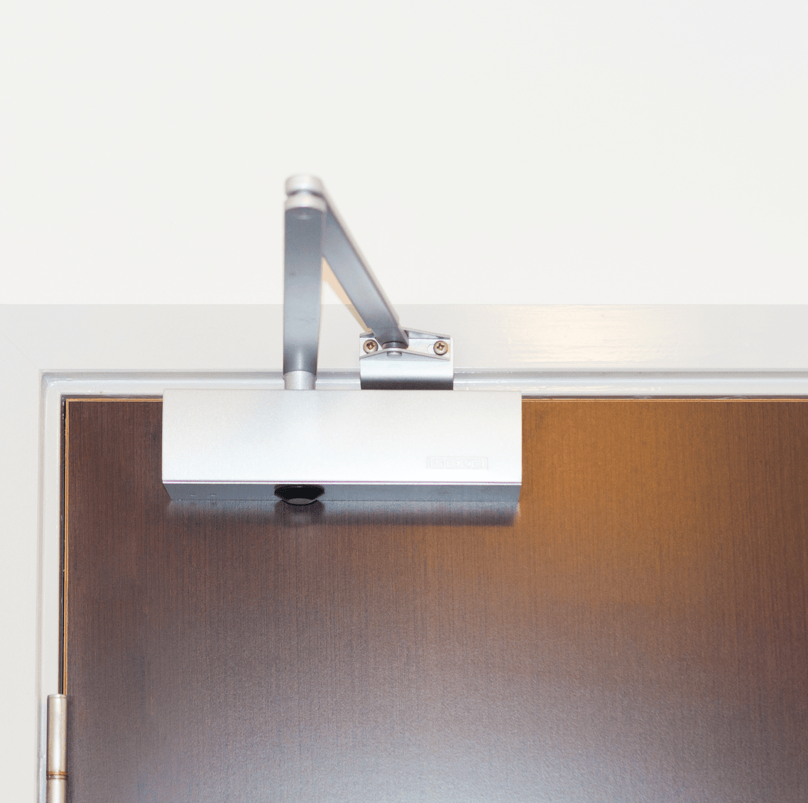 A new door closer installed ready for use in a home.